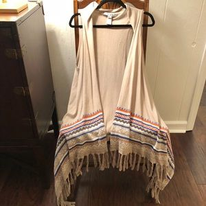 Fringed tan vest with tribal print details